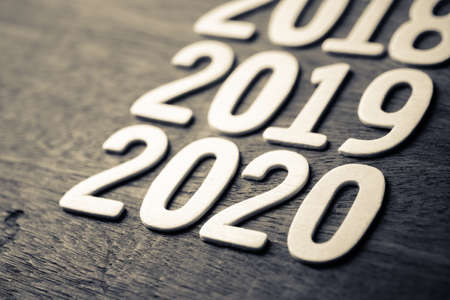 2018 to 2020 running year numbers by wood letters on wood background Stock fotó