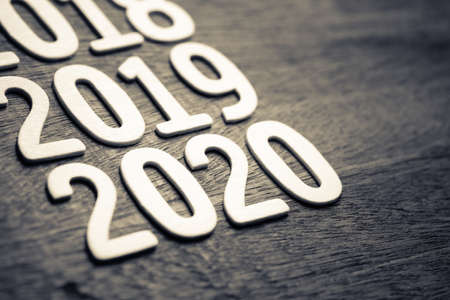 2018 to 2020 running year numbers by wood letters on wood background