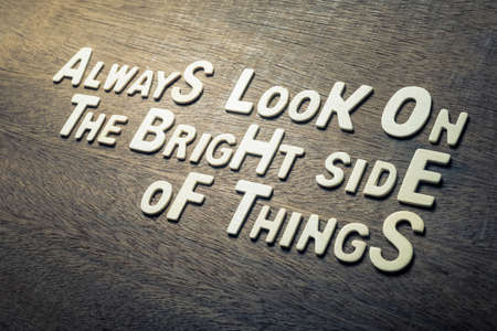 Success quote concept by wood alphabets arranged on wood wall, Always Look on the Bright Side of Things Imagens