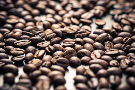 Many coffee beans as coffee concept background, focus at the middle of frame with shallow depth of field