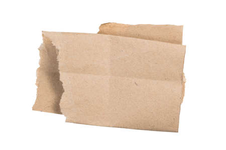 Torn and folded brown paper, piece of packaging paper as notepad isolated on white