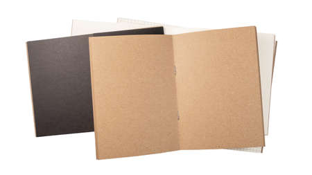 Pile of opened notebook in different design as background or space for text, isolated on white background