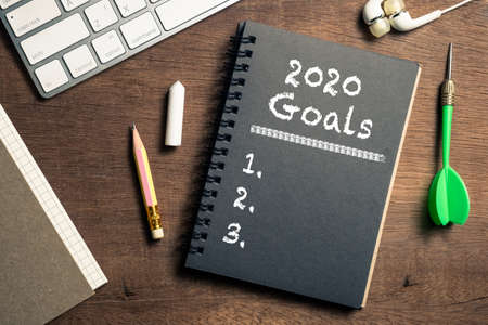 2020 Goals plan as text on empty notebook on the desk