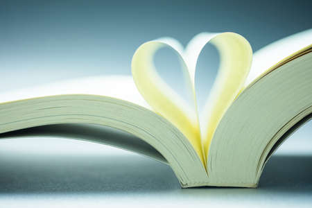 Closeup opened pocket book with folded pages as a heart sign Stockfoto