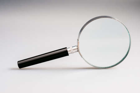 Magnifying glass on gray background