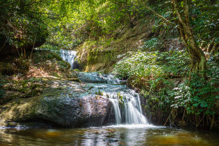 Small waterfall in tropical forest, Huay Kamin Noi Watefall in Phu Hin Rong Kla National Park, Central of Thailand Stockfoto - 133547613