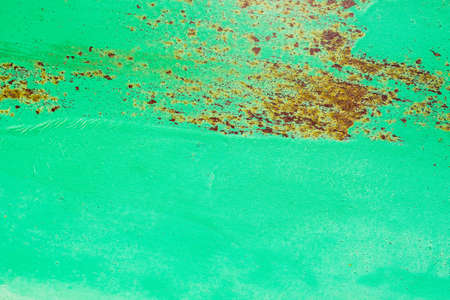 Abstract background of metal painted in green color with some rust, metal texture Stockfoto