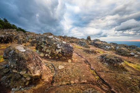 Lan Hin Poom, Famous viewpoint in Phu Hin Rong Kla National Park, show the geology of knobby rock terrace in windy and cloudy day Banco de Imagens
