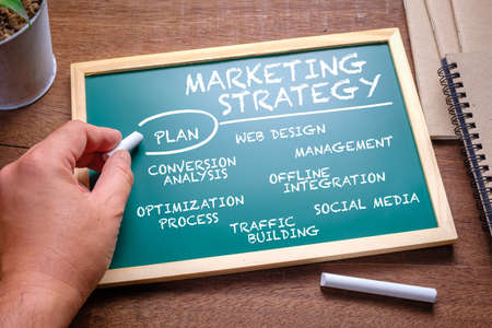 Hand writing a digital marketing strategy concept on chalkboard