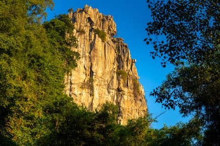 Limestone mountain in tropical forest at Tham Pha Ta Pol Non Hunting Area