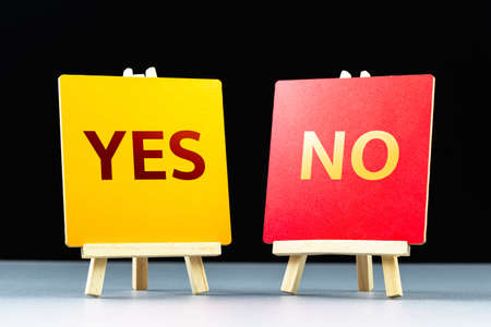 YES and No answer on two tripod easels for voting concept