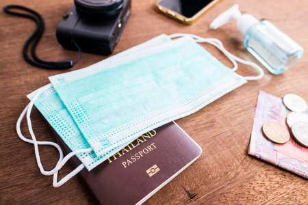 Hygienic face mask with some belongings for travel in coronavirus or covid-19 global pandemic, new normal concept