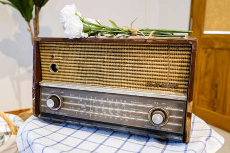 Retro portable radio in the living room, outdate radio boombox become a decoration object in modern house