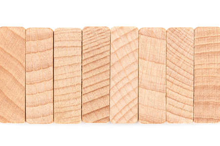 Closeup detail of cut wood pieces (top side of wood domino)  arranged in stack row, wood texture and element