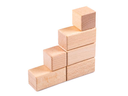 Stair step made from wooden block toy isoalted on white background, symbol object for business growth and success or teamwork concept