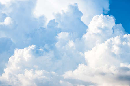 Fluffy big white clouds in fine weather day, clouds and sky background Banco de Imagens