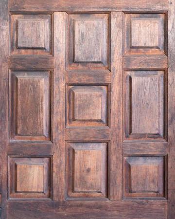 Closeup part of old hardwood door in old Thai house, old style wood door, wood texture 版權商用圖片