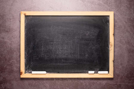 Empty small blackboard with dust and chalk on the wall 版權商用圖片