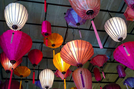 Colorful paper lanterns lamp hanged on the ceiling, decoration in Vietnamese restaurant in Thailand 版權商用圖片