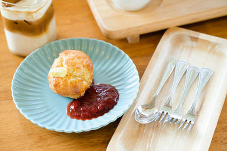 Scones bread with butter and strawberry jam served in the coffee shop
