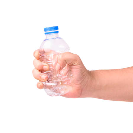 Closeup hand crushing small plastic bottle isolated on white