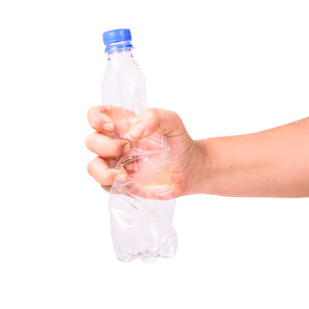 Closeup hand crushing transparent water bottle isolated on white background