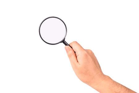 Closeup hand holding magnifying glass to analyze something isolated on white