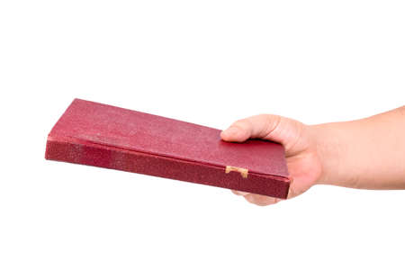 Closeup hand holding a hardcover old book