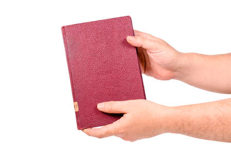 Closeup man holding a hardcover old book with two hands 写真素材
