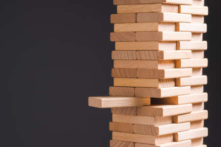 Closeup wood tower built by wooden domino toy