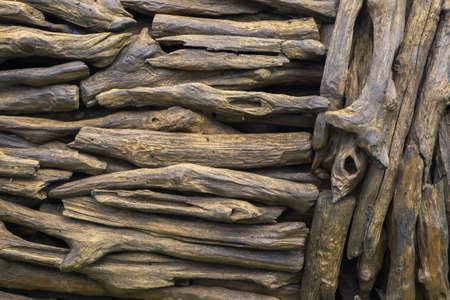 Designed woodwork built from many pieces of twig as a wall or fence, wood texture and background