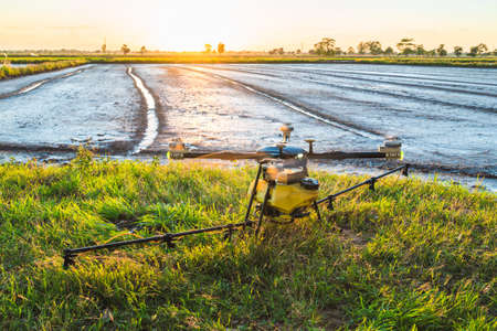 Herbicide spraying drone going to takeoff to work on the rice field, countryside of Thailand 写真素材