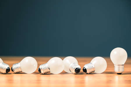 Many small light bulbs fall down, the concept for unsuccess idea, the disadvantage of small business in crisis