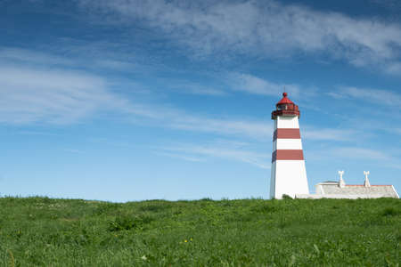 Lighthouse in summer, Alnes,  Godoy island, on the west coast  in Norway