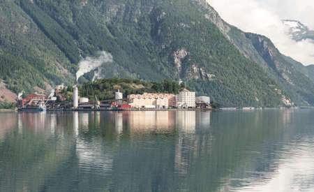 Odda Town with small houses on a Fjord in Summer, Norway