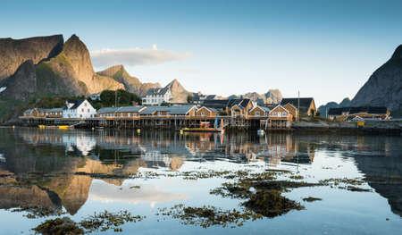Yellow Fishing hut on the Lofoten islands in summer, northern Norway. Stock Photo