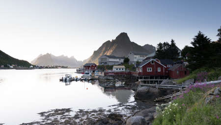 Red Fishing hut on the Lofoten islands in summer, northern Norway. Stock Photo