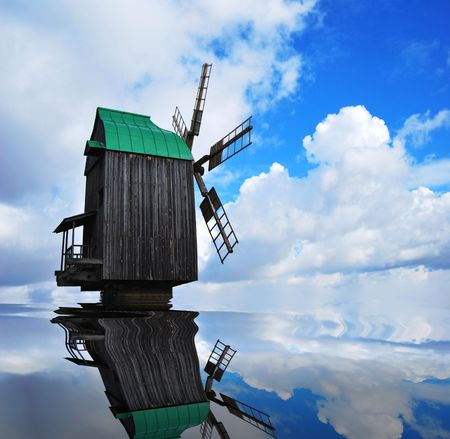 Old abandoned windmill with blue sky in background