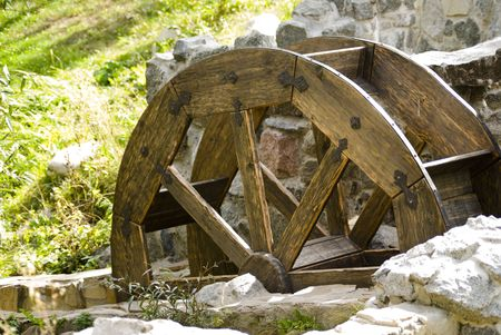 Old watermill with a wooden wheel and stone walls  Banco de Imagens