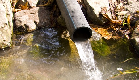 sewage pipe polluting the river