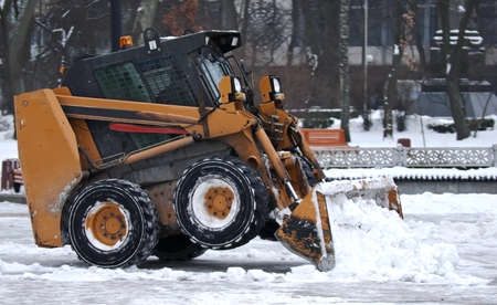 Excavator clears snow on the streets of Kiev Ukraine photo