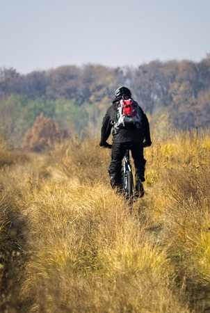 non moving activity: cyclist in autumn forest