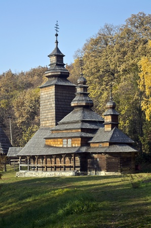 old wooden church in the Carpathian Mountains photo