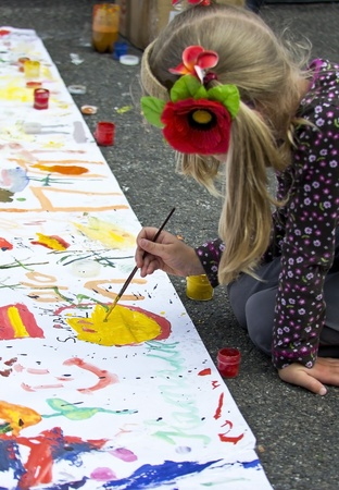 write off: Girl paints pictures on a poster