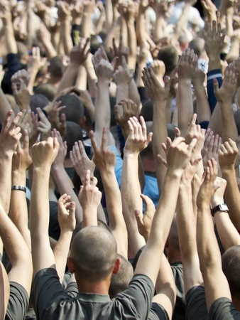 hands of the people in the crowd