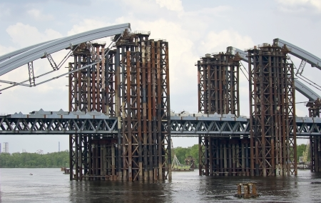 steel construction: construction of a bridge across the river Stock Photo