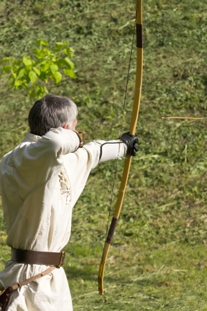 man shoots and classic bow photo
