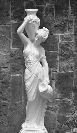 Girl sculpture park with an amphora  Banco de Imagens