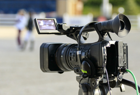 high definition television: work videographer camera before shooting Stock Photo