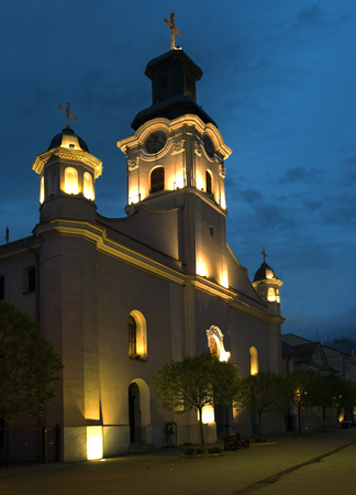 Old Catholic church against the background of the night sky.